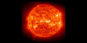Nasa: Ionized helium atoms at about 60,000 °C  in the Sun's chromosphere emit the ultraviolet light seen in this image.
